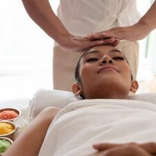 Asian girls are a relaxing head massage in the Spa Salon. Thai massage for health